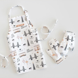 This is a colorful kids apron by Kristie Kern called San Francisco.
