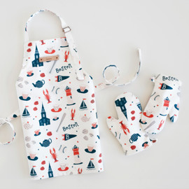 This is a colorful kids apron by Kristie Kern called Boston.