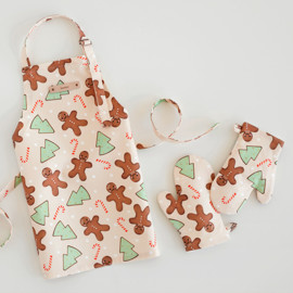 This is a colorful kids apron by Jennifer Lew called Gingerbread.