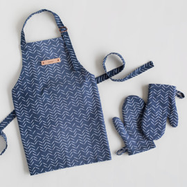 This is a blue kids apron by Lehan Veenker called Herringbone Incomplete.