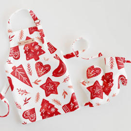 This is a red kids apron by Petra Kern called Simple Xmas.
