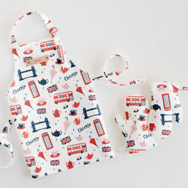 This is a colorful kids apron by Kristie Kern called London.