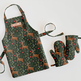 This is a green kids apron by Elly called Festive Deer.
