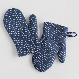 This is a blue kids apron by Lehan Veenker called Herringbone Incomplete in standard.