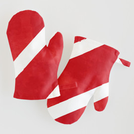 This is a red kids apron by Hooray Creative called Candy Cane Stripes.