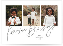 This is a white kwanzaa card by Kristel Torralba called Kwanzaa Blessings with standard printing on signature in standard.
