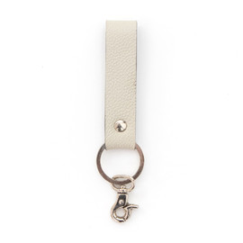 This is a white leather keychain by Minted called Cloud Grey.