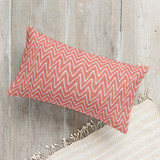 This is a white pillow by Hooray Creative called Watercolor Chevron printing on premium cotton.