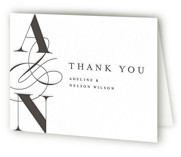 This is a black wedding thank you card by Pixel and Hank called Norman with letterpress printing on coventry320 in standard.
