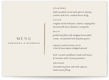 This is a beige menu card by Carolyn Nicks called Eloquent with foil-pressed printing on signature in standard.