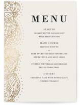 This is a beige menu card by Oma N. Ramkhelawan called Elegant Henna with foil-pressed printing on signature in standard.
