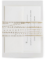 This is a gold belly band by Ana Sharpe called Rippling Waters in belly band.