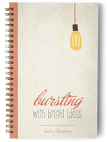This is a red journal by BusyNothings called Bright Ideas with standard printing on premium cover stock in notebook.