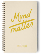 This is a beige journal by jot and tittle design called mind over matter with standard printing on premium cover stock in notebook.