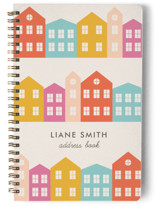 This is a orange journal by Amber Barkley called Little Houses with standard printing on premium cover stock in notebook.