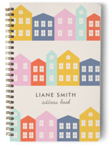 This is a yellow journal by Amber Barkley called Little Houses with standard printing on premium cover stock in notebook.