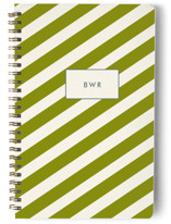 This is a green journal by Toast & Laurel called Haberdashery with standard printing on premium cover stock in notebook.
