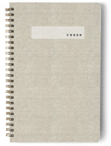 This is a brown journal by Susan Brown called Minimal Linen with standard printing on premium cover stock in notebook.