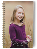This is a white journal by Phrosne Ras called My Name Is with standard printing on premium cover stock in notebook.