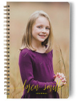 This is a yellow journal by Phrosne Ras called My Name Is with standard printing on premium cover stock in notebook.