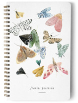 This is a white journal by Emilie Simpson called Moths with standard printing on premium cover stock in notebook.