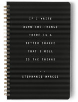 This is a black journal by Lea Delaveris called Letterboard with standard printing on premium cover stock in notebook.