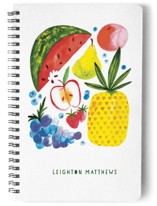 This is a red journal by Patrice Horvath called Fruit Family with standard printing on premium cover stock in notebook.