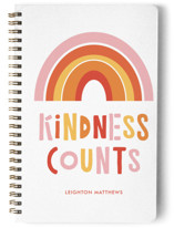 This is a orange journal by Erika Firm called Kindness Counts Rainbow with standard printing on premium cover stock in notebook.