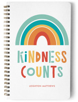 This is a red journal by Erika Firm called Kindess Counts Rainbow with standard printing on premium cover stock in notebook.