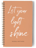 This is a orange journal by Lorena Depante called Let your light shine with standard printing on premium cover stock in notebook.