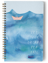 This is a blue journal by Kanika Mathur called Paper Boat with standard printing on premium cover stock in notebook.