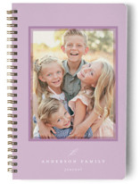 This is a purple journal by Emily Betts called Sweet Frame with standard printing on premium cover stock in notebook.
