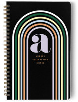This is a black journal by Baumbirdy called Retro Rainbow with standard printing on premium cover stock in notebook.