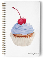 This is a blue journal by Denise Junek called Pink Cupcake with standard printing on premium cover stock in notebook.