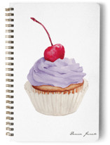 This is a purple journal by Denise Junek called Pink Cupcake with standard printing on premium cover stock in notebook.