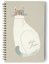 This is a beige journal by Monika Drachal called Feline Notes with standard printing on premium cover stock in notebook.