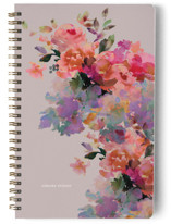 This is a purple journal by Lori Wemple called Blooming Bouquets with standard printing on premium cover stock in notebook.