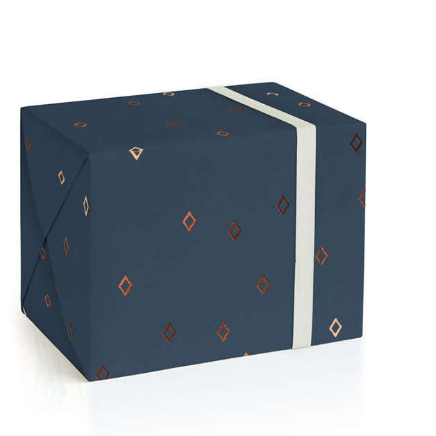 This is a blue wrapping paper by Liz Conley called Tiny Diamonds.