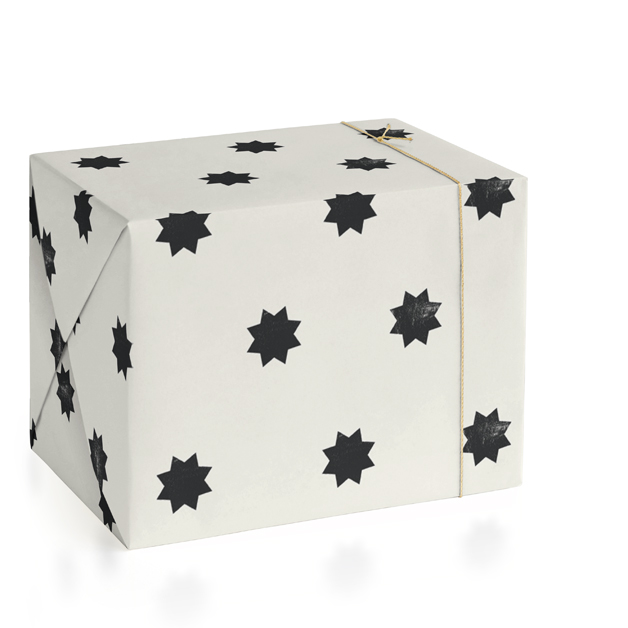 This is a ivory wrapping paper by Rebecca Durflinger called geo stars.