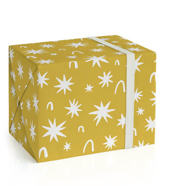 This is a yellow wrapping paper by Chi Hey Lee called Starcharm.