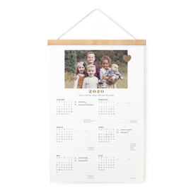 This is a gold hanging bar calendar by Sara Hicks Malone called Mom Love with foil-pressed printing on signature in one-page calendar.