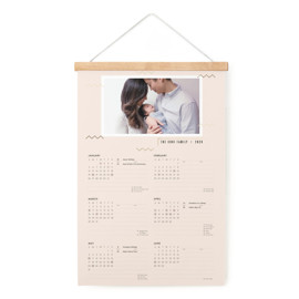 This is a gold hanging bar calendar by Moglea called Adagio with foil-pressed printing on signature in one-page calendar.
