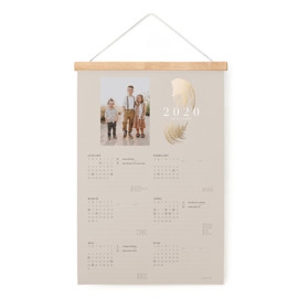 This is a gold hanging bar calendar by kelli hall called Brushed gold leaf with foil-pressed printing on signature in one-page calendar.