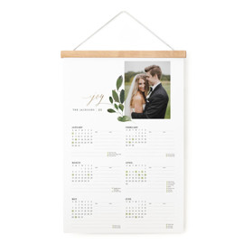 This is a green hanging bar calendar by Lori Wemple called Botanical Spray with foil-pressed printing on signature in one-page calendar.