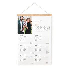 This is a rosegold hanging bar calendar by Jessica Williams called Elegant Last Name with foil-pressed printing on signature in one-page calendar.