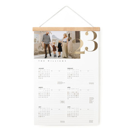 This is a gold hanging bar calendar by Jessica Williams called Foil Year with foil-pressed printing on signature in one-page calendar.