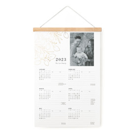 This is a gold hanging bar calendar by Amy Kross called Trailing Vines with foil-pressed printing on signature in one-page calendar.
