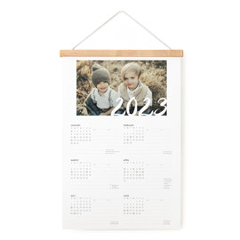 This is a white hanging bar calendar by Jennifer Lew called Sincere Year with standard printing on signature in one-page calendar.