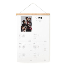 This is a black hanging bar calendar by Lori Wemple called Modern Type with standard printing on signature in one-page calendar.