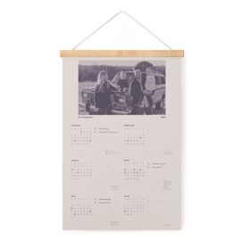 This is a blue hanging bar calendar by Jack Knoebber called Zine with standard printing on signature in one-page calendar.